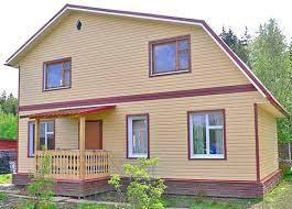 Дом отделанный виниловым и цокольным сайдингом