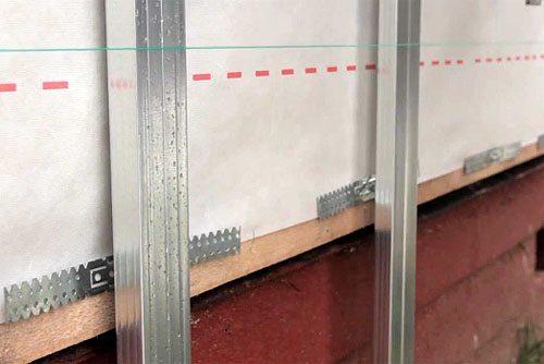 Металлическая обрешетка дома под сайдинг с утеплением