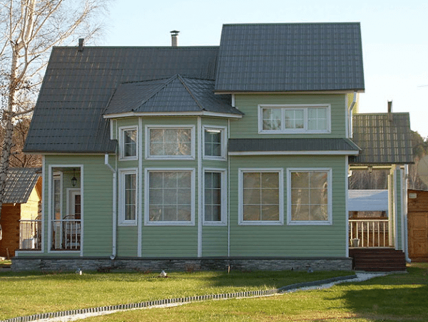 Фото дома, отделанного сайдингом
